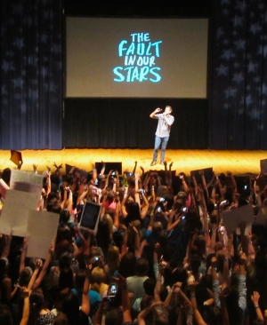 The crowd cheers author John Green, before stars Shailene Woodley, Ansel Elgort, and Nat Wolff emerge from behind the starry curtain.